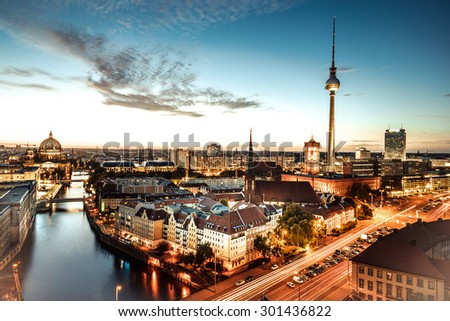berlin sunset with television tower and cathedral - stock photo