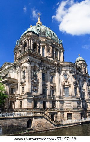 Berliner Dom with river and some clouds - stock photo