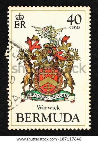 BERMUDA - CIRCA 1984: Postage stamp printed in Bermuda with image of Bermuda Warwick parish's coat of arms. - stock photo