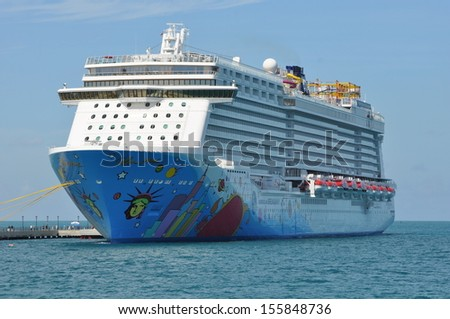 BERMUDA - SEPTEMBER 13: Norwegian Breakaway, NCL's newest and largest cruise ship, as seen on September 13, 2013 in Bermuda. It is the largest cruise ship homeported year-round from New York City. - stock photo