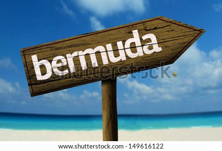 Bermuda wooden sign with a beach on background - stock photo