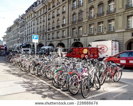 BERN APR 11: Bicycles parking area near the train station in Bern, Switzerland on April 11, 2011. Using bicycle is convenient way for transportation in many of big cities in Europe. - stock photo
