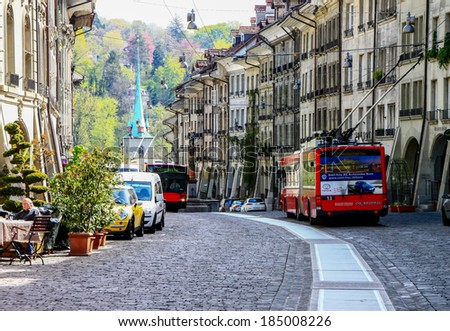 BERN -APR 11:  Streets in the old medieval city of Bern, Switzerland on April 11th, 2011. In 1983 the historic old town in the centre of Bern became a UNESCO World Heritage Site - stock photo
