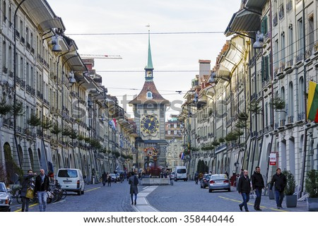 BERN, SWITZERLAND - DECEMBER 22, 2015: The east front of the Clock Tower (1191-1256), Zytglogge, Swiss Cultural Property of National Significance located at the end of the Kramgasse in Old City - stock photo