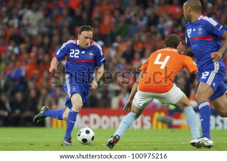 BERN, SWITZERLAND - JUNE 13:  Franck Ribery of France drives the ball during a Euro 2008 match against the Netherlands June 13, 2008 in Bern, Switzerland.  Editorial use only. - stock photo