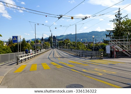 BERN, SWITZERLAND - SEPTEMBER 13, 2015: Bridge over the Aare river (Kirchenfeldbrucke) connects the Casino square in Old Town to the Helvetiaplatz, was inaugurated in 1883, it is 229 m long bridge - stock photo