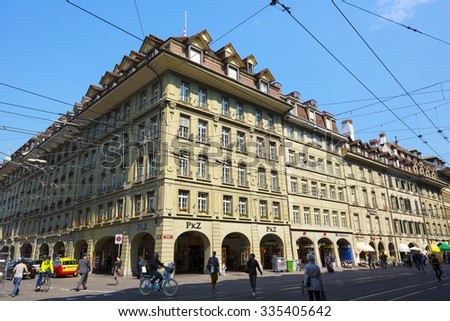 BERN, SWITZERLAND - SEPTEMBER 11, 2015: The Massive townhouse at Spitalgasse, and tram infrastructure creates an image of the busy city which is the fourth most populous city in the Country  - stock photo