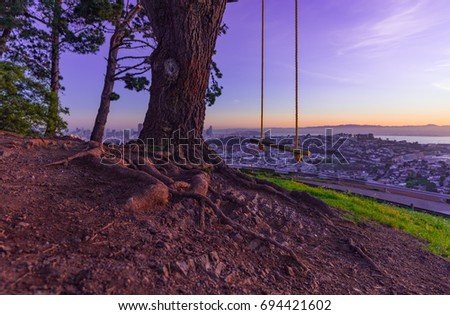 Bernal heights park swing sunrise stock photo royalty free bernal heights park swing at sunrise publicscrutiny Images