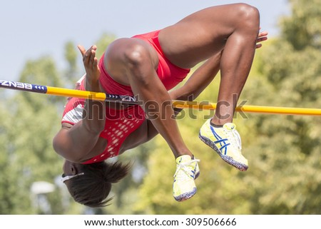 BERNHAUSEN, GERMANY - August 08: The Picture shows the heptathlete Sharon Day-Monroe high jumping at the Thorpe Cup, which  is an international track and field competition between USA and Germany. - stock photo