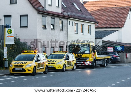 BERNHAUSEN, GERMANY - NOVEMBER 08,2014: Two maintenance cars and a tow truck of ADAC (The German Automobile Association) are about to leave for their next client after fixing a broken car on November - stock photo