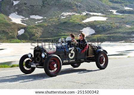 BERNINA PASS, SWITZERLAND - JUNE 14: A black Ford Model A takes part to the Summer Marathon classic car race on June 14, 2014 at Bernina Pass. This car was built in 1930 - stock photo