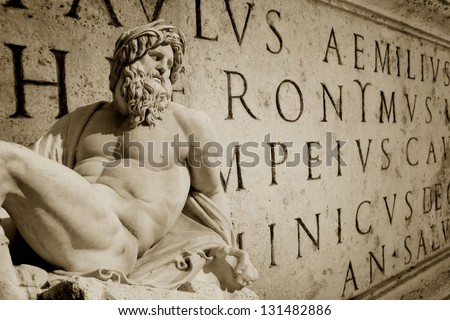 Bernini statue detail of Gange with Latin words engraved on a wall Roman Capitol - stock photo