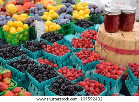 Berries and preserves at outdoor farmers market - stock photo