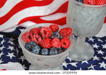 berries in goblets on flag - stock photo