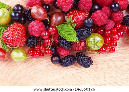 Berries on a wooden background - stock photo