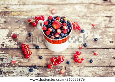 Berries on Wooden Background. Summer or Autumn Organic Berry over Wood. Agriculture, Gardening, Harvest Concept  - stock photo