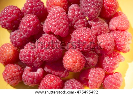 Berries raspberries on a light background. Top view.