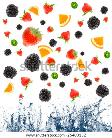 berry and fruit falling in juice. Isolation - stock photo