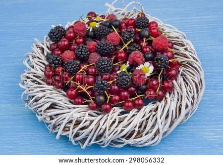 berry assortment - raspberries, blackberries, currants - stock photo