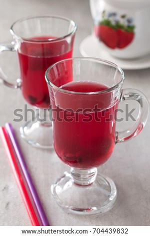 Berry compote made of strawberries and currants. Berry red fruit jelly in a glass