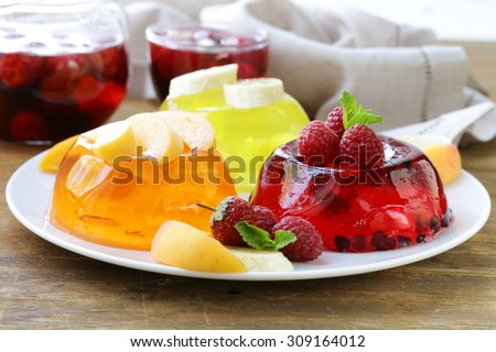 berry fruit jelly with fresh berries - summer dessert