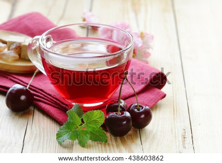 berry fruit tea in a glass cup - stock photo