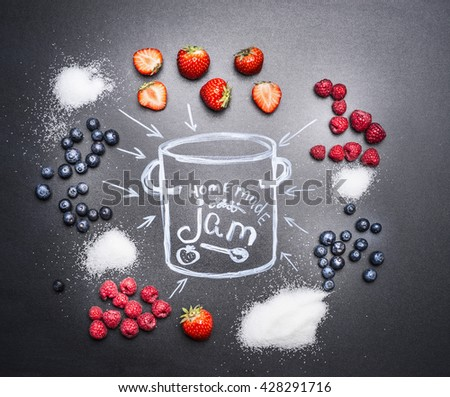 berry jam ingredients for a variety of berries, sugar and drawn with chalk on a chalkboard pan top view - stock photo