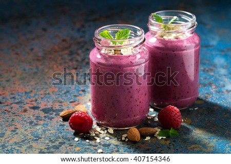 berry smoothie in a bottle on a dark background, horizontal, closeup