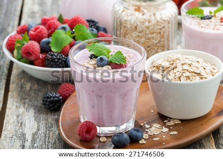 berry smoothie with oatmeal in a glass on wooden table, close-up - stock photo