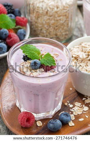berry smoothie with oatmeal in a glass, vertical, top view, close-up - stock photo