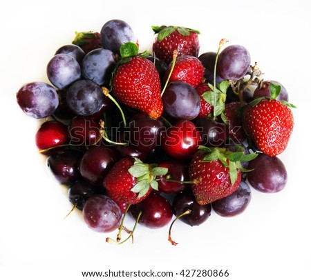 Berry still life. Strawberries, grapes and cherries - stock photo