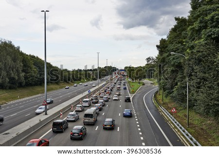 BERTEM, BELGIUM - AUGUST 12, 2014: Picture shows lots of car stucked in Bertem cloverleaf, on the highway E40, as works in august 2014 - stock photo