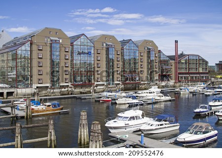 Besides the old traditional warehouses  in the immediate neighborhood located this shopping center in Trondheim - stock photo