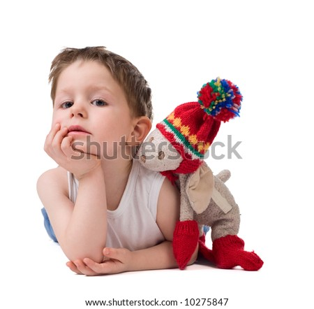 Best friends. Cute 3-4 years old boy with his best toy friend. Studio shot over white. - stock photo