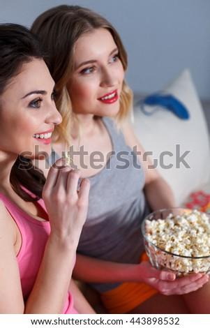 Best friends enjoying movie together - stock photo