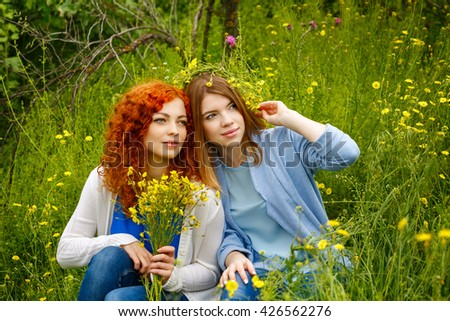 Best friends forever. Friends sitting on the grass in the park. BFF. Close friends - stock photo