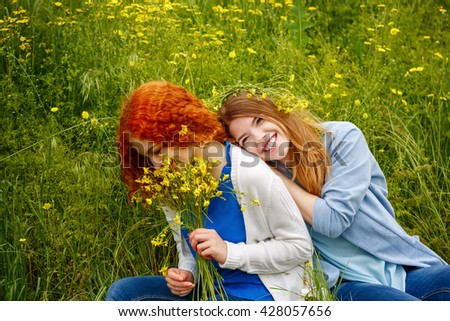 Best friends forever. Girlfriends hugging in the park. BFF. Close friends. Gentle friendship. Soft focus - stock photo