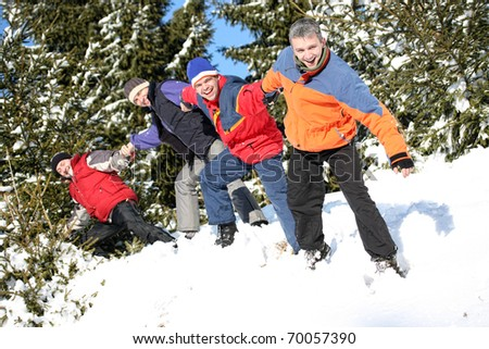 Best friends pull each other on the snow - stock photo