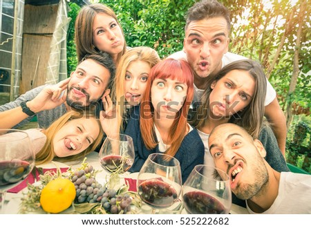 Best friends taking selfie at lunch party with funny faces - Happy youth concept with young people having fun together drinking wine - Cheer and friendship at grape harvest time - Bright vivid filter