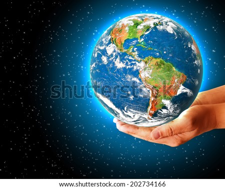 Best Internet Concept of global business from concepts series. Globe on her hands, South and North America. Elements of this image furnished by NASA - stock photo