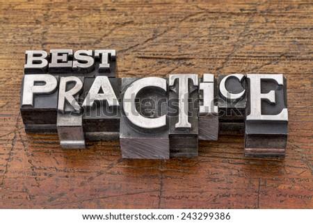 best practice words in mixed vintage metal type printing blocks over grunge wood - stock photo