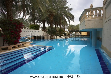 Best rest in magnificent hotel about picturesque pool - stock photo
