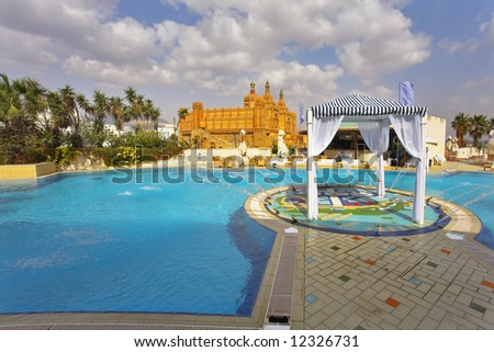 Best rest in magnificent hotel about picturesque pool and fountain - stock photo