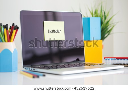 Bestseller sticky note pasted on the laptop - stock photo