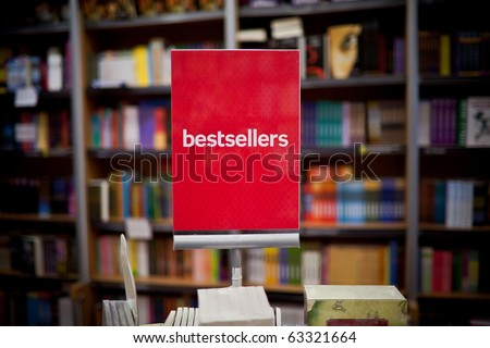 Bestsellers area in bookstore - many books in the background. - stock photo