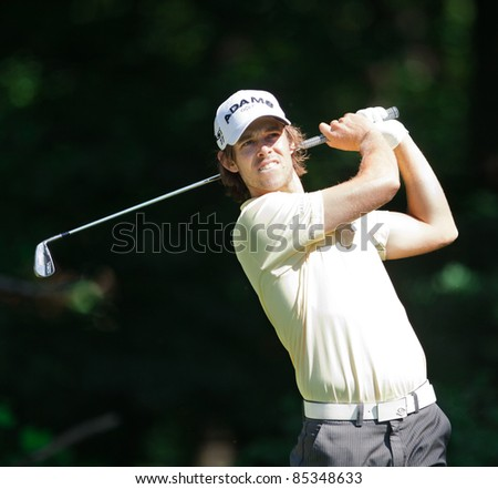 BETHESDA, MD - JUNE 15: Aaron Baddeley hits a shot at Congressional during the 2011 US Open on June 15, 2011 in Bethesda, MD. - stock photo