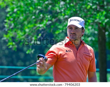 BETHESDA, MD - JUNE 15: Defending US Open Champion, Graeme McDowell, hands his driver to his caddie while playing in the 2011 US Open at Congressional on June 15, 2011 in Bethesda, MD. - stock photo
