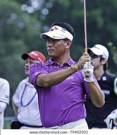 BETHESDA, MD - JUNE 14: K.J. Choi hits his drive off the 6th hole at Congressional during the 2011 US Open on June 14, 2011 in Bethesda, MD. - stock photo