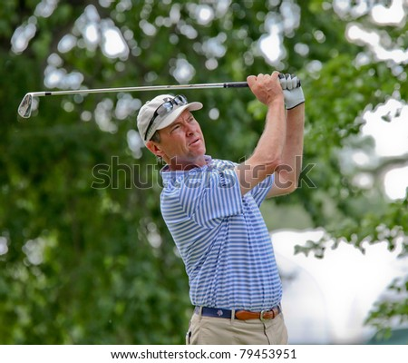 BETHESDA, MD - JUNE 14: Ryder Cup captain, Davis Love III, hits a shot at Congressional during the 2011 US Open on June 14, 2011 in Bethesda, MD. - stock photo