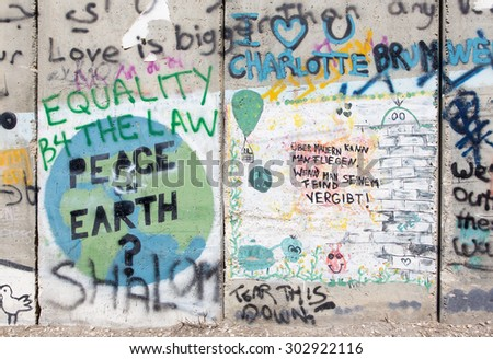 BETHLEHEM, ISRAEL - MARCH 6, 2015: The Detail of graffitti on the Separation barrier.       - stock photo